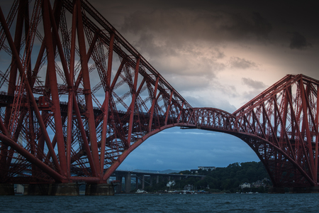Famous Forth Railway Bridge at evening  The Forth Bridge is railway bridge across the Firth of Forth in Scotland, west of Edinburgh City Centre. Stock Photo