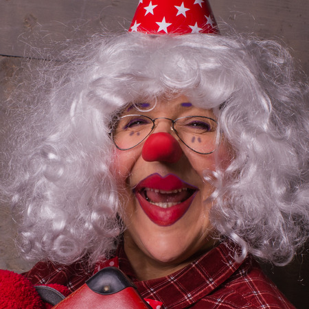 Funny clown with blonde wig, glasses and red nose. Foto de archivo