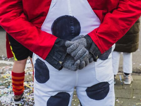Man in a funny trousers holding his hands behind his back. Stock fotó