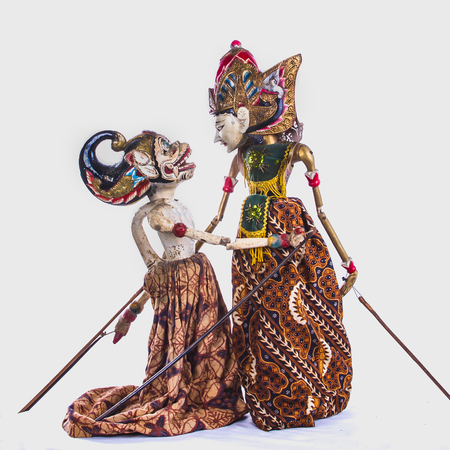 Two female  javanese dolls in emotional scene traditional dress
