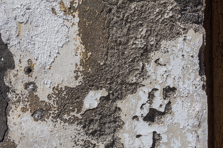 Surface of old  white wall with black gray stains.  Textured background macro.