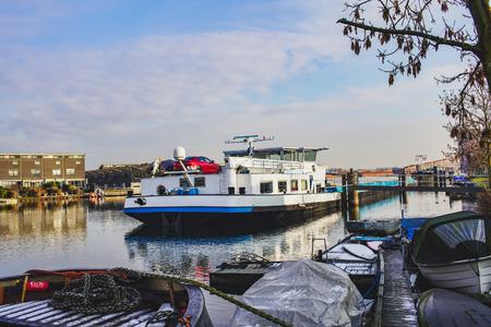 Cargo ship on the waterway in winter, the Netherlands Reklamní fotografie