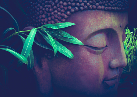 large decorative tinted sculpture of Buddha between green spring plants in an exotic garden Standard-Bild