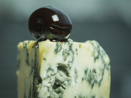 A typical Roquefort is a excellent French blue cheese  with mold from Combalou caves of Roquefort-sur-Soulzon. Stock Photo