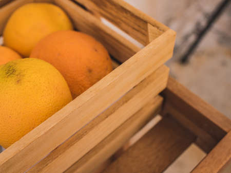 Blurred fresh orange fruits at retail store. Grocery market blurred background. Archivio Fotografico