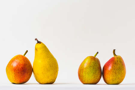 Group of four fresh pears on a white background with copy space 免版税图像