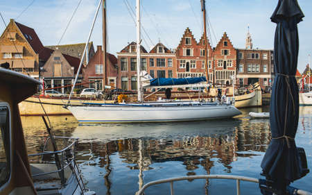 Sailing ships and dutch buildings in characteristic Hoorn, Netherlands Standard-Bild