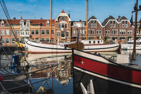 Sailing ships and dutch buildings in characteristic Hoorn, Netherlands Фото со стока