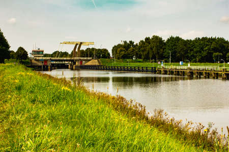 View of landscape with canal and Marksluis in Oosterhout, Netherlands.
