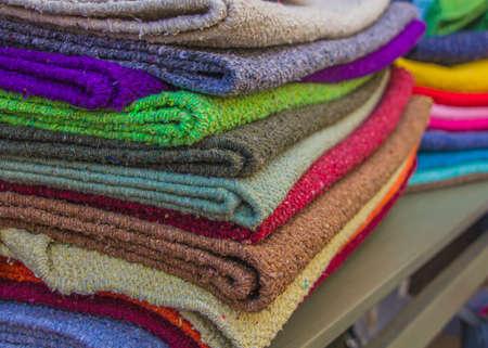 Rough Scottish natural carpets in market. Closeup fragment.