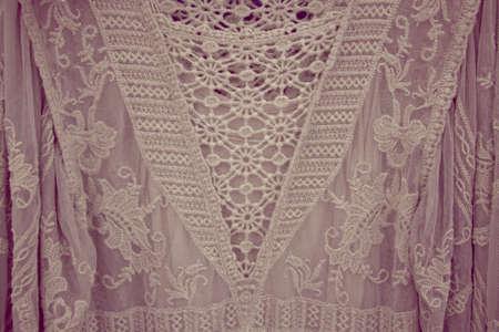 Pastel beige lace fabric with ruffles. Fashion closeup detail macro.