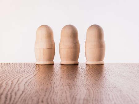 Blank Russian nesting dolls. Unpainted wooden nesting dolls on the table. Banco de Imagens