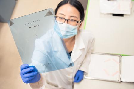 Scientist working on gel results