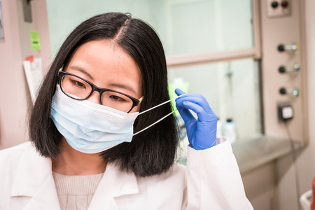 putting up: Putting up mask in the lab Stock Photo