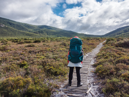 woman backpacker on the trail Stock Photo