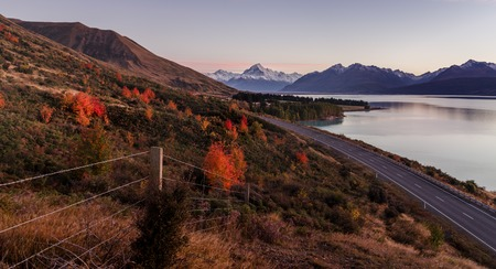mount cook viewpoint with the lake pukaki and the road leading to mount cook village. Taken during autumn in New Zealand. Stock Photo