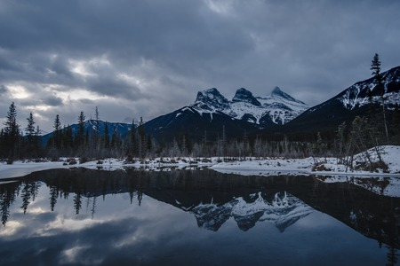 Gloomy day with the Three Sisters Reflecting on the Water