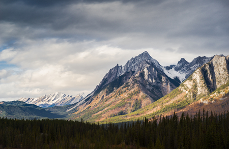 Dramatic Cloudscape Sky and Distant Snowcapped Mountain Peaks Canadian Rockies Stock Photo