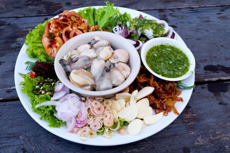 Freshly set oyster with tasty seafood dipping sauce.