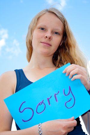 singn: Women show shield: Sorry Stock Photo