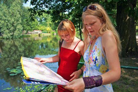 lady's: Map reading Stock Photo