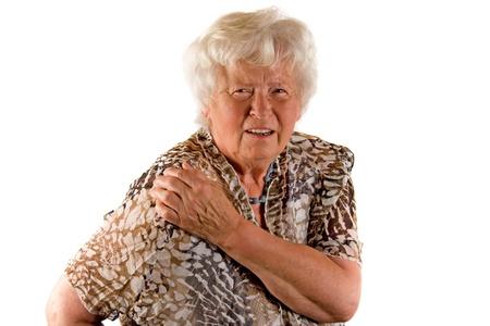 dolor hombro: Senior Dama con dolor de hombro