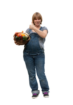nourishment: Young pregnant woman with a fruit basket for healty nourishment on white background Stock Photo