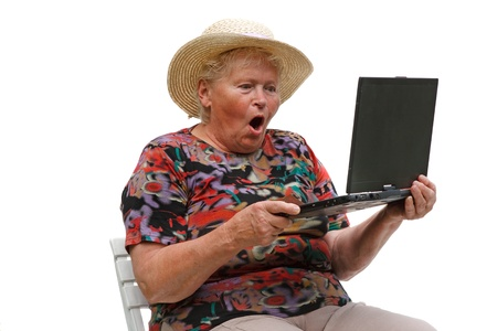 Senior woman with a computer on white background photo