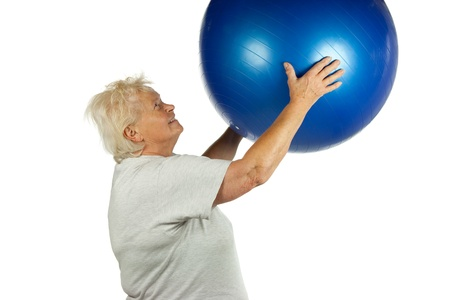 Senior woman with a fit ball on white background photo
