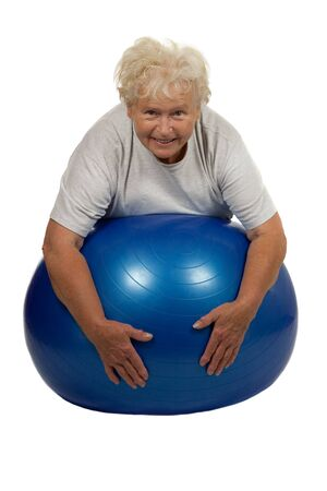 elderly exercise: Senior woman with a fitball on white background Stock Photo