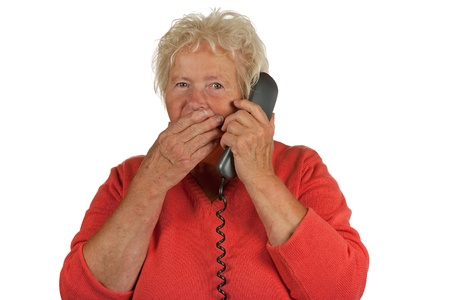 Senior woman gets a bad message on telephone, on white background Stock Photo - 10411414