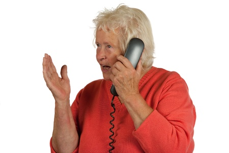 telephoning: Senior woman is discussing while telephoning, on white background