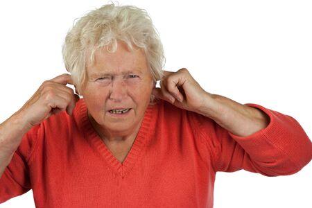 senior woman shut her ears on white background photo
