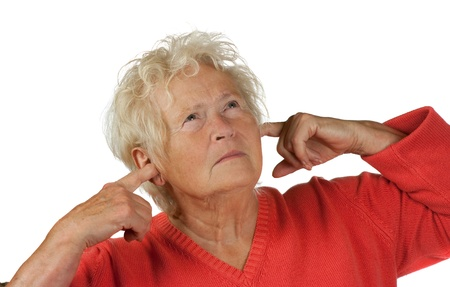 senior woman shut her ears on white background photo