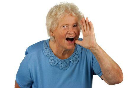Senior woman is shouting loud, on white background photo