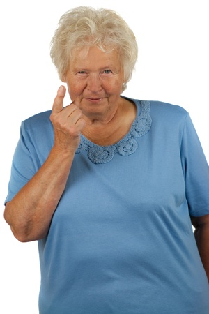 scepticism: Senior woman with lifted forefinger on white background