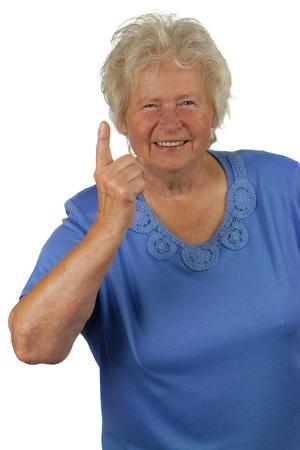 forefinger: Senior woman whit forefinger up, on white background Stock Photo