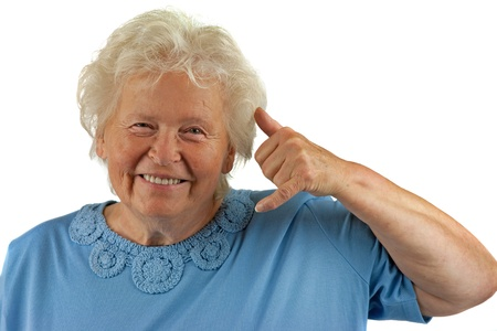 call me: senior woman is making a call me gesture Stock Photo