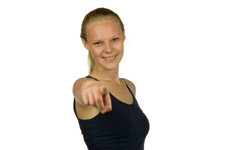 yoy: Young woman is pointing into the camera