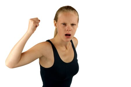 aggressive people: Young angry woman on white background Stock Photo