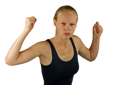 assail: Young angry woman on white background Stock Photo