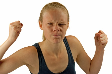 Young angry woman on white background photo