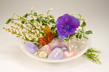 Differnt gemstones with blossoms for therapy photo
