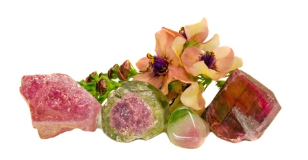 crystal therapy: Natural tourmaline gem stones and mullein (verbascum) blossoms Stock Photo