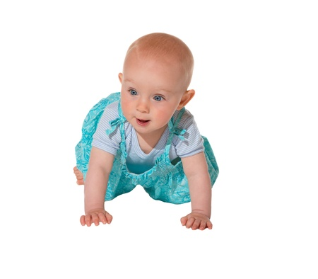 Adorable crawling baby with a happy alert expression facing the camera dressed in a turquoise blue outfit Stock Photo - 14129248