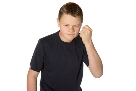 vengeful: Angry casual young man in a black t-shirt with glaring eyes shaking his fist at the camera isolated on white Stock Photo