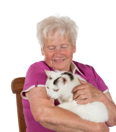 stroking: Smiling granny sitting on chair and holding her cat - isolated on white