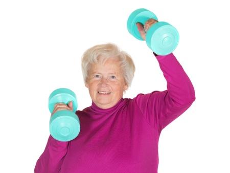 lebensfreude: Begeisterte �ltere Dame arbeitet mit Gewichten, um ihre Vitalit�t und Lebensfreude in ihrer Pensionierung zu erhalten