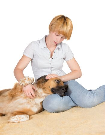 devoted: Loving woman with her large gentle crossbreed dog lying with its head on her lap stroking it