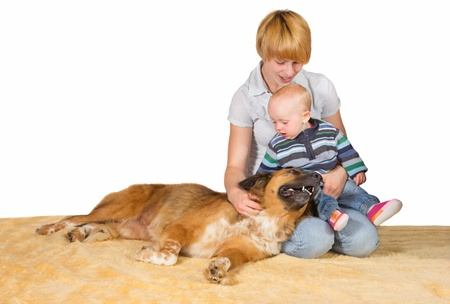 Devoted Mum, small baby and family dog sitting on the floor close together sharing a moment of love and tenderness with copyspace photo